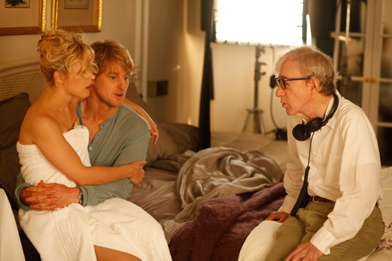 Woody Allen directs Owen Wilson and Rachel McAdams through an intimate scene.