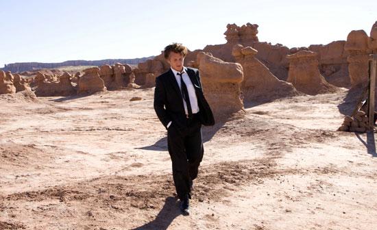 Sean Penn strolling a desolate landscape