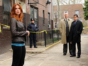 Carrie Wells (Poppy Montgomery), Det Mike Costello (Michael Gaston) and Del Al Burns (Dylan Walsh) from 'Unforgettable