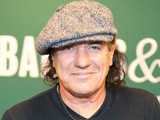 Brian Johnson of AC/DC signs his new memoir 'Rockers and Rollers' in New York