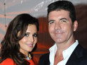 Cheryl Cole is given an effigy of her former boss Simon Cowell by British troops.