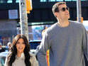 Kim Kardashian dismisses reports that she is pregnant with fiancé Kris Humphries's child.