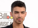Joe Jonas was spotted with model Karlie Kloss at Saturday's polo game featuring Prince William.