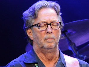 Eric Clapton performing alongside Steve Winwood in London