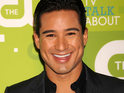 Mario Lopez films his proposal to Courtney Mazza to be broadcast on Extra.