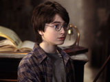 A young Daniel Radcliffe picks up his wand in Harry Potter and the Philosopher&#39;s Stone