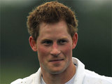 A muddy Prince Harry after a charity match of Polo, England