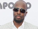 Wyclef Jean receives the National Order of Honor and Merit from Haiti's President Michel Martelly.