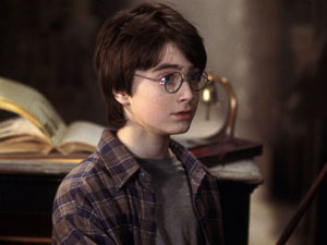 A young Daniel Radcliffe picks up his wand in Harry Potter and the Philosopher's Stone