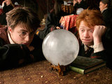 Harry and Ron Weasley (Rupert Grint) look into a crystal ball in Divination class.