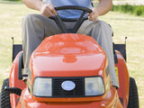 Man riding a lawnmower