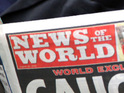 A former-News of the World executive is sacked by The Sun for serious misconduct.