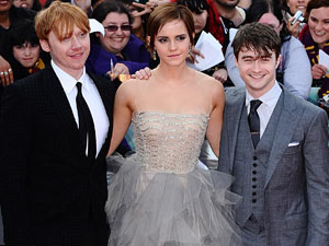 Rupert Grint, Emma Watson and Daniel Radcliffe arriving at the premiere