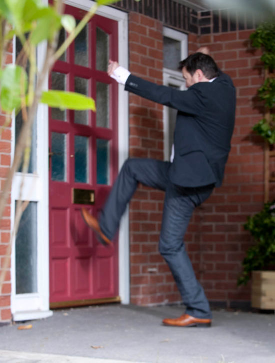 Owen arrives at the door and hears Izzy's cries for help