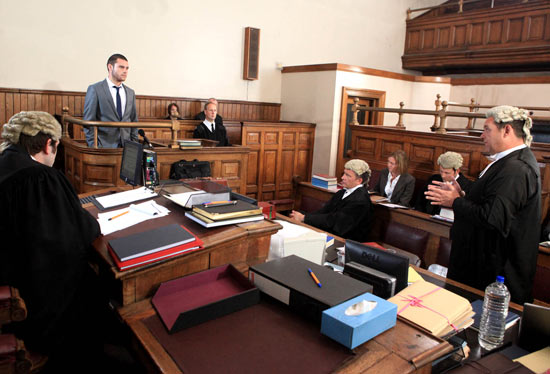 Its Aaron's turn in court but he doesn't seem interested when questioned