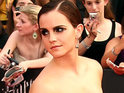 Emma Watson is photographed kissing actor Johnny Simmons during a date in California.
