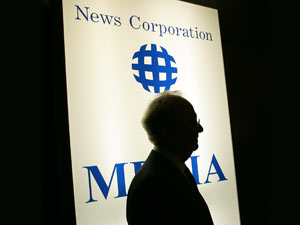 Rupert Murdoch in front of a News Corporation logo