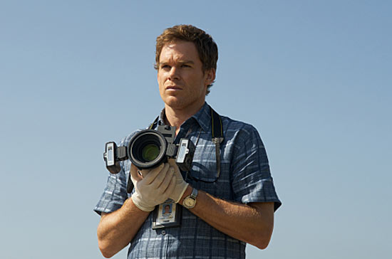 Dexter holds a camera