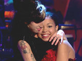 Amy Winehouse supporting Dionne Broomfield after she performed her debut single in 2009. 