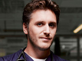 Greg Douglas (Edward MacLiam) from Holby City