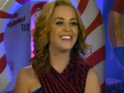 Katy Perry shows off her new blonde hairstyle during an interview.