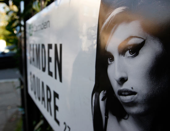 A picture of Amy Winehouse seen stuck to the Camden Square road sign
