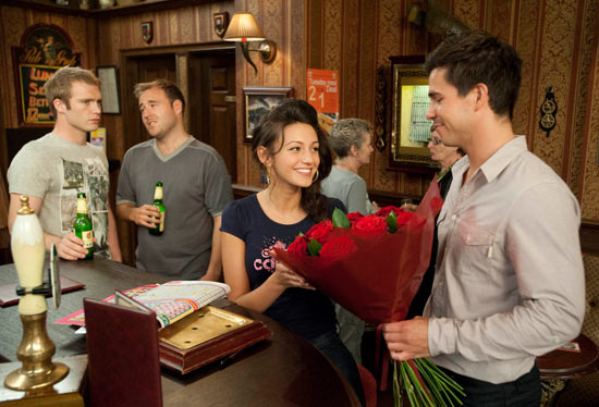 Tommy is jealous when Dr Carter arrives with flowers for Tina