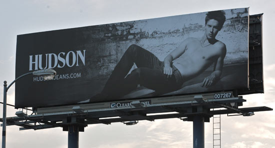Patrick Schwarzenegger poses shirtless for Hudson Jeans on a Sunset Boulevard billboard Los Angeles.