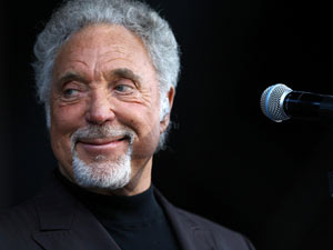 Tom Jones performs on stage at Newbury racecourse.