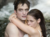 Edward and Bella embrace in the lagoon