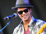 Bruno Mars performing.