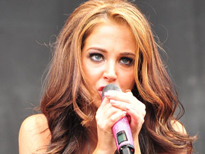 On the day of her X Factor debut, Tulisa performs with N-Dubz