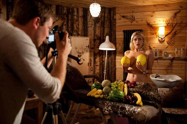 Carmel (Gemma Merna) posing with Melons