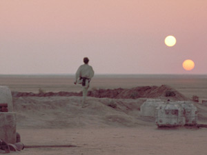 Luke stares out at Tatooine's two suns