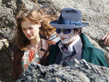 Johnny Depp and Bella Heathcote filming new Tim Burton movie 'Dark Shadows' on location on a remote beach in Devon
