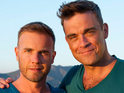 Gary Barlow says Robbie Williams had to pay him to use his phone.