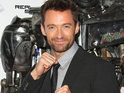 Hugh Jackman claims the director came up with the idea to use real robots.