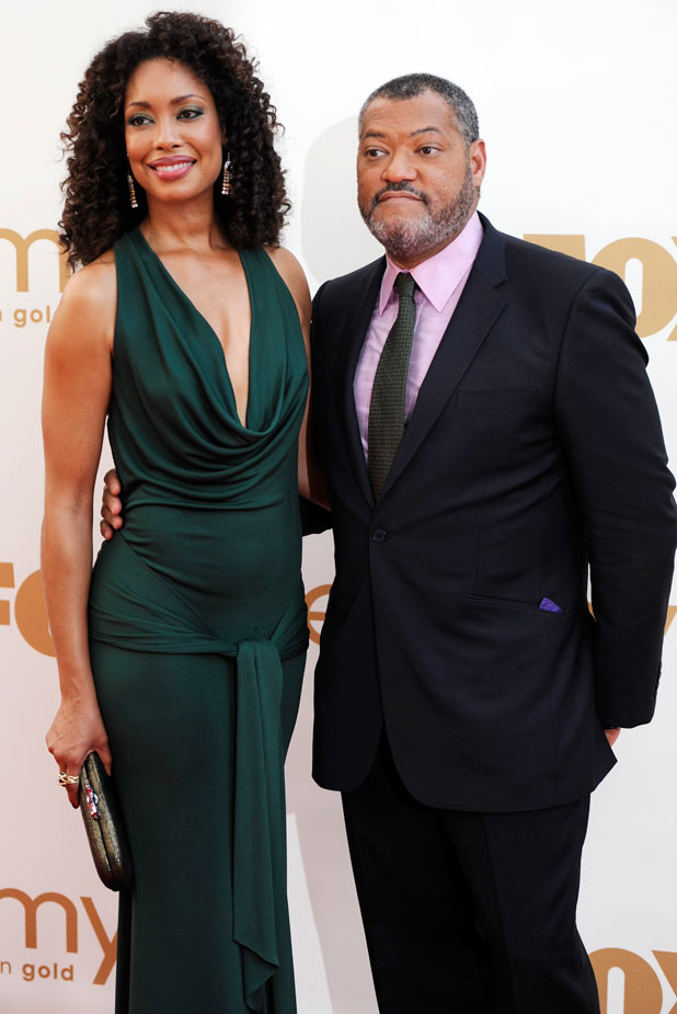 Gina Torres, left, and Laurence Fishburne on the red carpet at the 63rd Primetime Emmy Awards