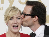 Kate Winslet, left and Guy Pearce hold the Emmys for best actress and best supporting actor in a miniseries or movie