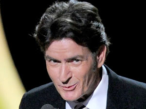 Charlie Sheen presents the award for outstanding lead actor in a comedy series at the 63rd Primetime Emmy Awards