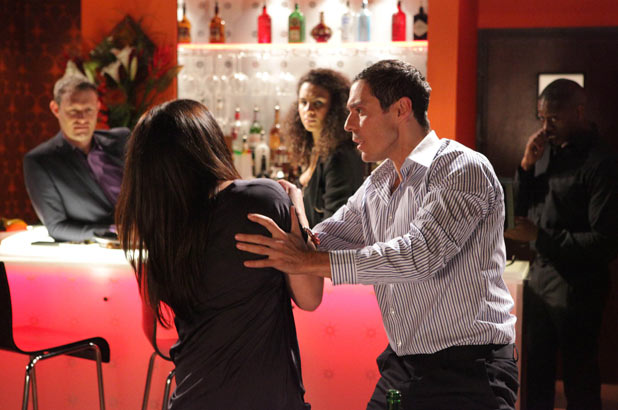 Carla leaps up and Rory grabs her to try to calm her down