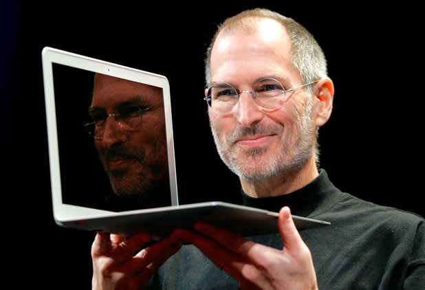 Steve Jobs holds up the new MacBook Air after giving the keynote address at the Apple MacWorld Conference in San Francisco, 2008