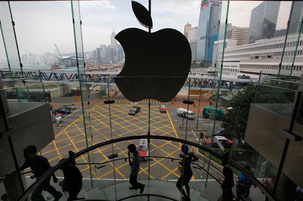 The lights on the Apple are switched off in memory of Steve Jobs at a store in Hong Kong