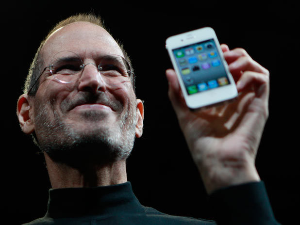 Steve Jobs holds the new iPhone 4 during the Apple Worldwide Developers Conference in San Francisco, 2010