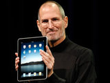 Steve Jobs shows off the new iPad during an Apple even in San Francisco, 2010