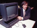Steve Jobs acting as president and CEO of NeXT Computer Inc, showing off the company's NeXTstation in San Francisco, 1990