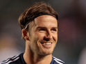 David Beckham signs with the LA Galaxy for two more seasons.