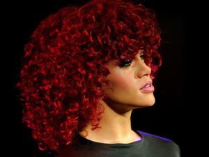 A new waxwork of Rihanna is unveiled at Madame Tussauds in London