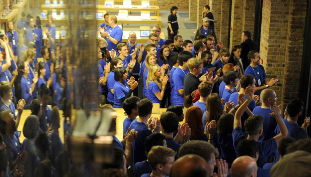 Staff at the Apple store in Covent Garden, London, to open as the iPhone 4S goes on sale