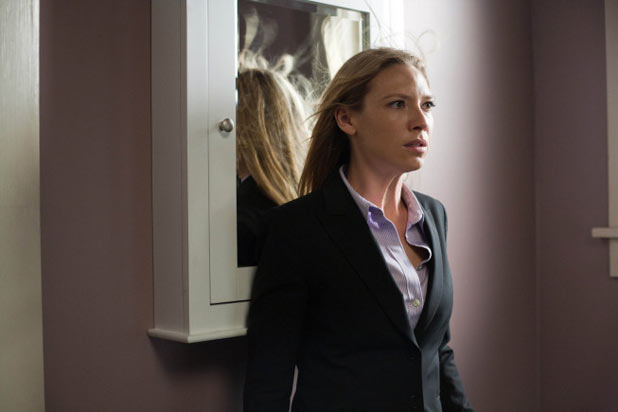 Olivia (Anna Torv) is haunted